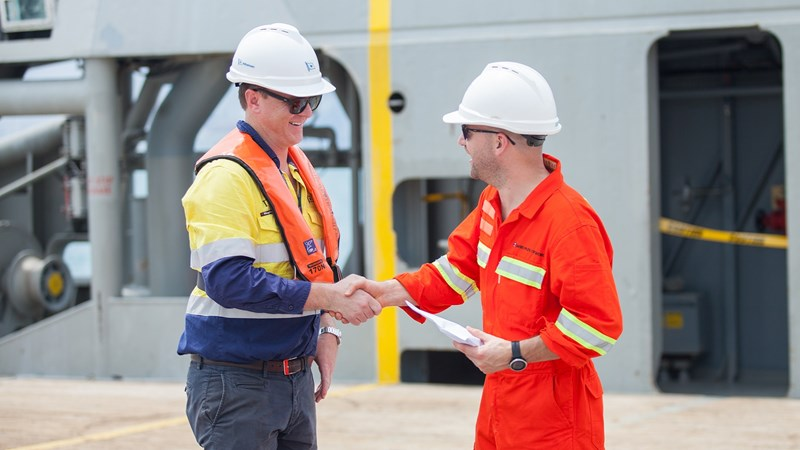 1600x900 Wilhelmsen Ships Agent and Swire Chief Engineer Receiving Parcel